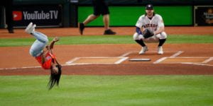 Simone Biles flipping before throwing out first pitch in GAME 2 of 2019 World Series.