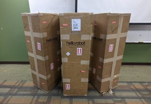 The three project robots in their boxes ready to be opened by the teams.