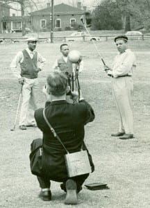 Reporter photographing Alfred Holmes, Charles Bell, and Oliver W. Holmes at North Fulton Golf Course, December 24, 1955
