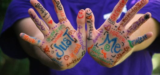 "hands of a person with ""Just me"" written on them"