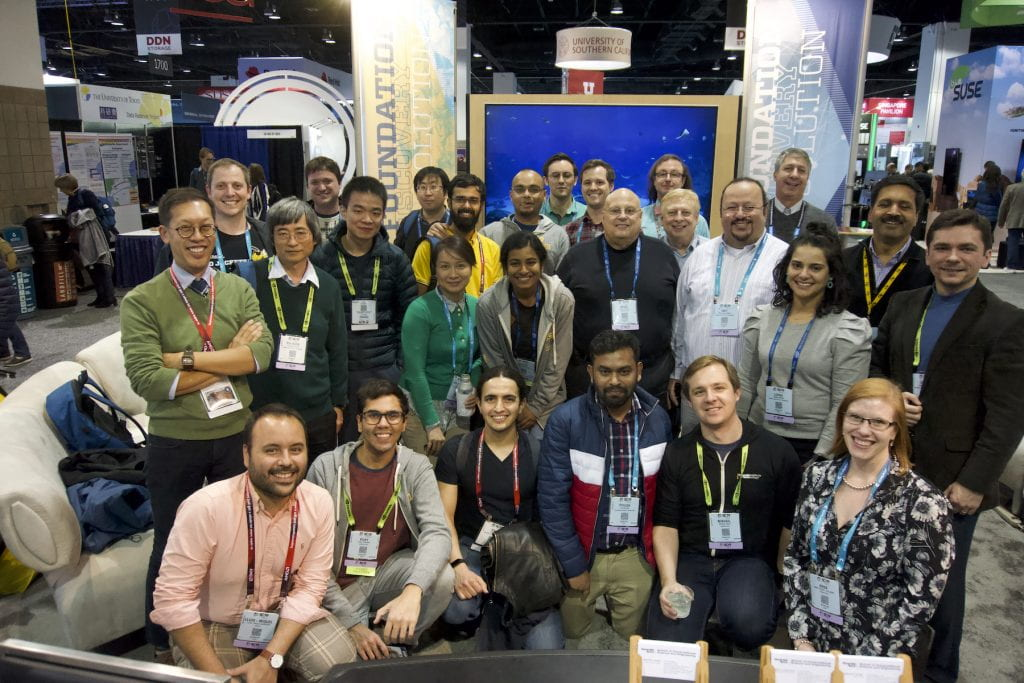Group photo of Georgia Tech researchers at SC19's show floor in Denver