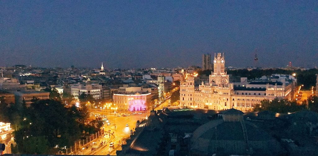 The city of Madrid fully alive at night.
