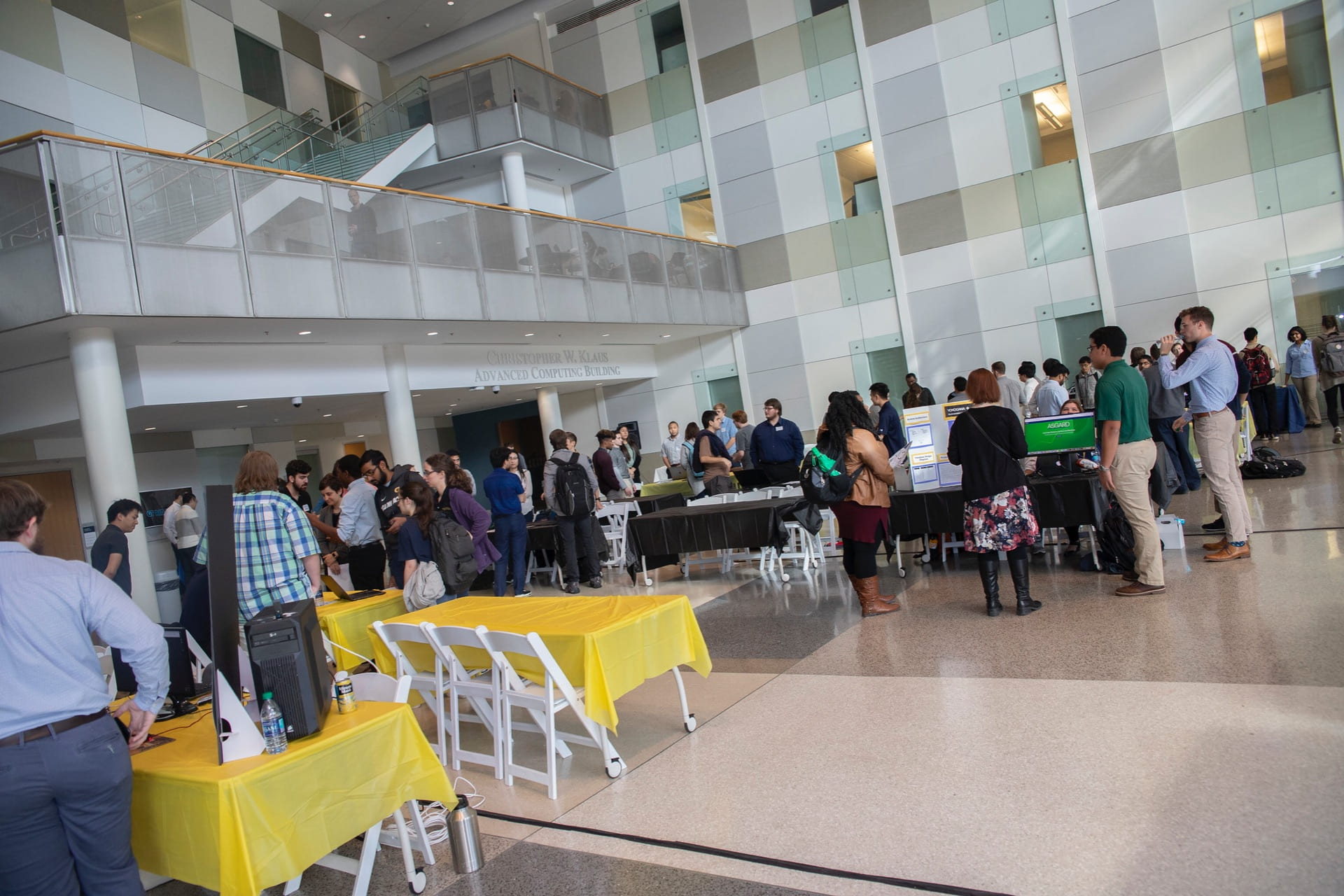 The Klaus Atrium is filled with people at a student capstone expo