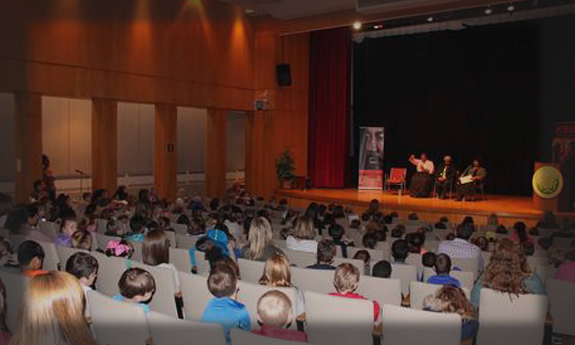 Auditorium with students and speakers