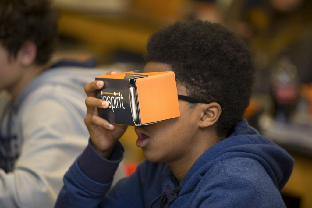 """A high school student uses a VR viewer to """"go inside"""" a plant cell as part of an AP Biology class in Cobb County, Georgia."""